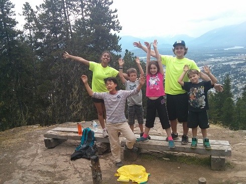 Kids with program leaders on a hike