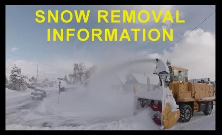 Snow blower clearing street